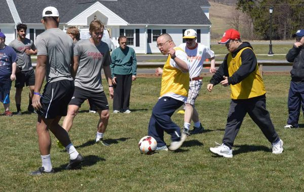 Colgate soccer players work on drills with residents of Pathfinder Village