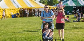 Tracy Scatterday '96 and her family on Whitnall Field at reunion.