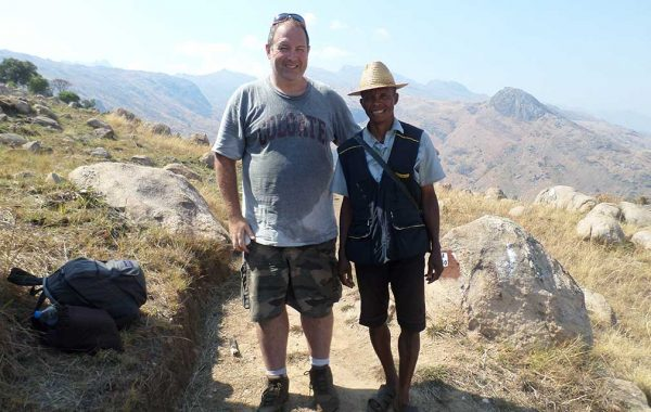 Gary Martenson '95 in Madagascar's Andringitra National Park with a porter.