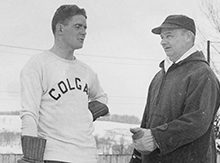 Coach Howie Starr and a hockey player outside on the ice