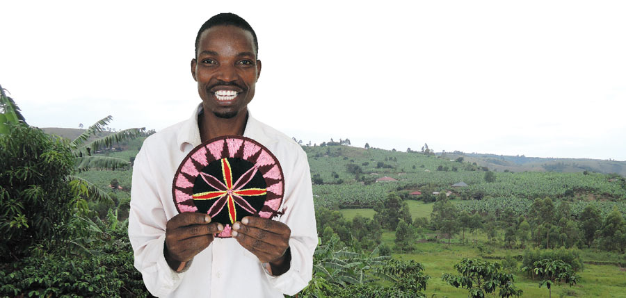 Edward presents a colorful circular wall hanging