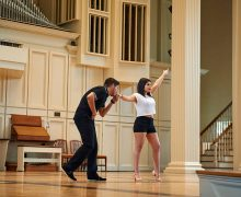 Two students perform a Friday Night Fever dance on stage at Memorial Chapel during Performing Arts Weekend