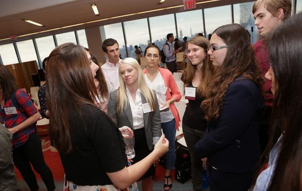 Jennifer Heldmann '98 speaks with a group of students and alumni