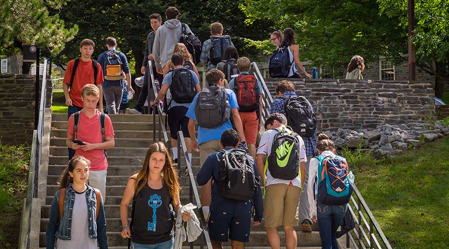 Students walk to class up and down the Persson stairs