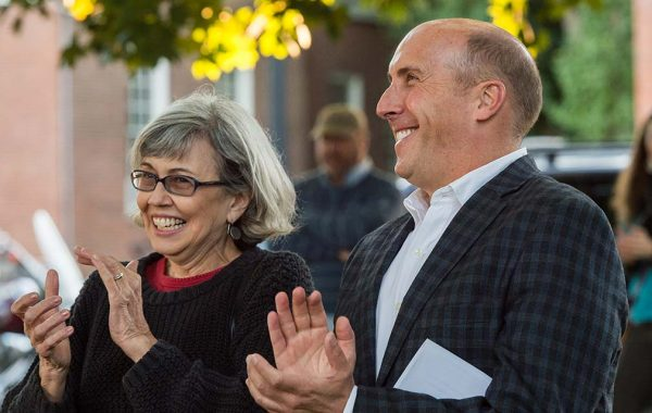 President Brian W. Casey and Jill Harsin applauding