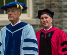 President Brian W. Casey in academic regalia prepares to enter Memorial Chapel