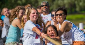 First-year students smile and strain during a tug of war competition