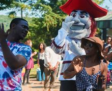 Students dancing with the Colgate Raider mascot outside ALANA.