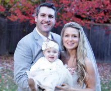 Wedding photo of Crystal and Evan with their daughter