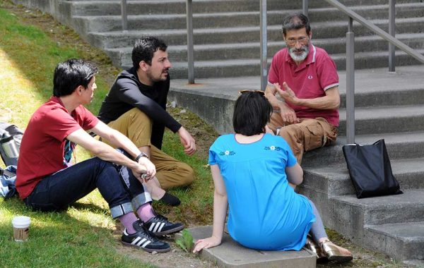 Group of four sitting on Persson steps having a discussion