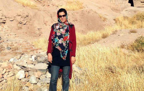 Naseema Noor '06 in dry Afghanistan landscrap