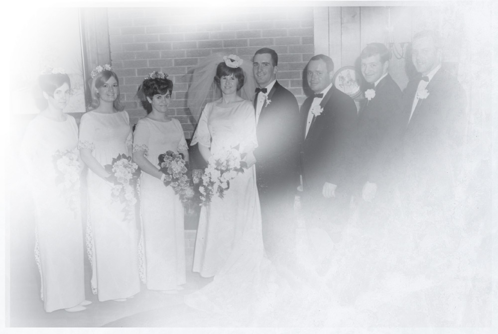Wedding photo, with Janet and Steve flanked by the bridal party