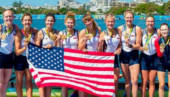 Lauren Schmetterling '10, fourth from left, standing with gold medal with her rowing teammates
