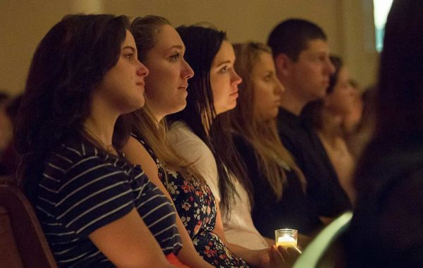 The campus community gathered in the chapel on Sept. 20, 2016, to honor the lives of Ryan Adams '19 and Cathryn (Carey) Depuy '19, who died on that date in a 2015 plane crash in Morrisville, N.Y. Konosioni invited people to the Quad before the vigil to write memories, wishes, or thoughts on colorful felt squares.