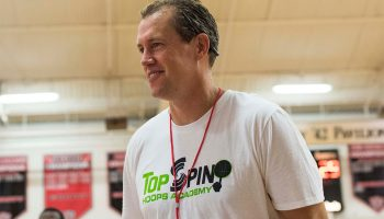 Jonathan Stone '92 coaching on the basketball court