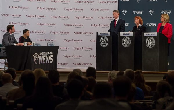 Claudia Tenney '83 debates two opposing candidates for Congress on stage at Memorial Chapel