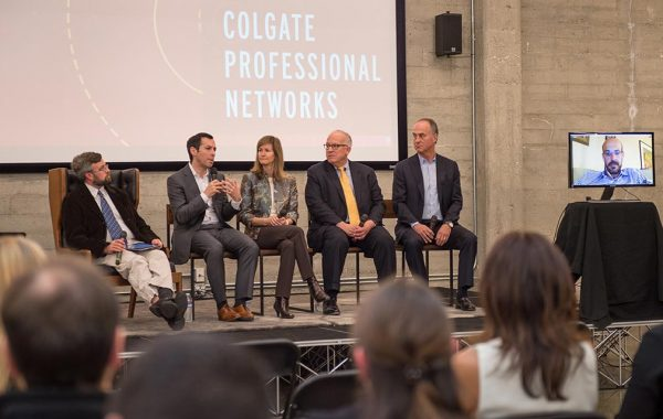 Panelists respond to questions on stage at a Professional Networks event.