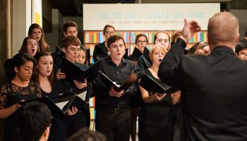 The chamber singers perform at the Picker Art Gallery's exhibition Marko Mäetamm: I Want to Tell You Something.