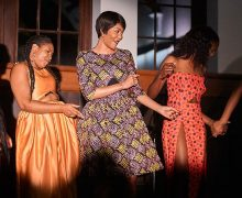 A group of Colgate students model African fashions on the catwalk