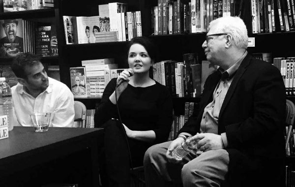 Mary Anna King '04 answers a question at a book reading, flanked by Chris Edwards '91 and Michael Hiltzik '73