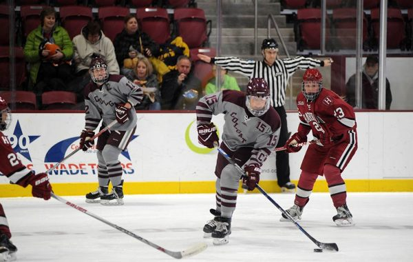Women's hockey playing against Harvard.