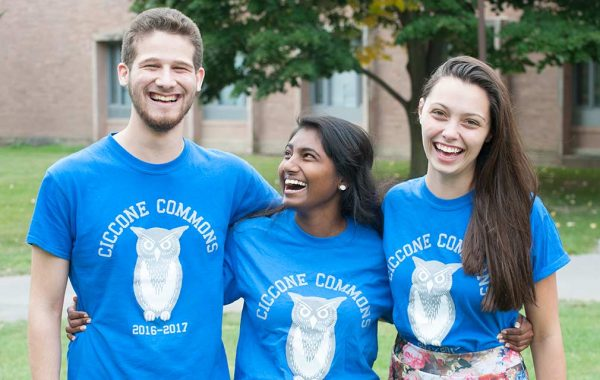Three students in Ciccone Commons shirts with owls on them