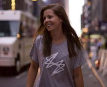 Photo of Katie Sullivan '12 walking down a street in NYC