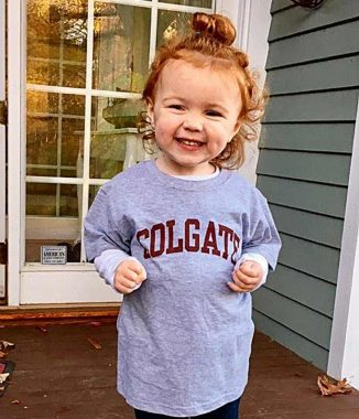 Two-year-old Madeleine Marsi, daughter of Stephen Marsi '01 and granddaughter of Rick Marsi '69, flashes her Colgate smile.