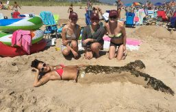 It's no tall tail: (L to R) Meghan Fogarty '13, Amanda Harris '13, Maddie Bell '13, and mermaid Jo Belluardo '13 won first place in a sandcastle competition in Rhode Island last summer.