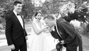 Tom Hanks kisses the hand of Elisabeth Murphy '11 while her new husband Ryan Barclay smiles in astonishment