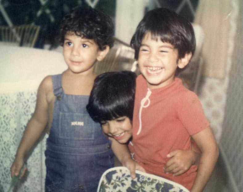 Chris and his siblings smiling for the camera as young children