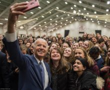 Joe Biden takes a selfie with a group of students