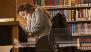 Student studying in the library.