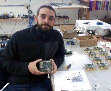Branden Christensen '06 in the lab, building his hand-held seismograph called Raspberry Shake.