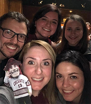 Group of students and alumni with a Colgate Raider cutout
