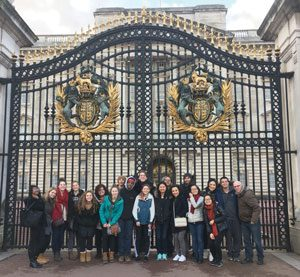 Group shot outside of Buckingham Palace