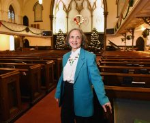 Marti Swords-Horrell '77 in her church's sanctuary