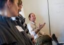 Attendees listen as a someone speaks