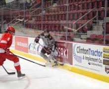 Women's hockey player along the boards vs. Cornell