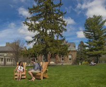Students lounge in two of the Quad's 13 new Adirondack chairs.