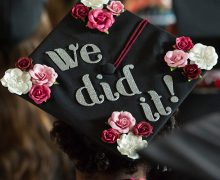 """We did it!"" on a decorated graduation cap"