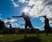 """Frisbros"" (men's ultimate Frisbee team members) practicing their throws."
