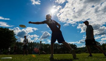 """Frisbros"" (men's ultimate Frisbee team members) practicing their throws."
