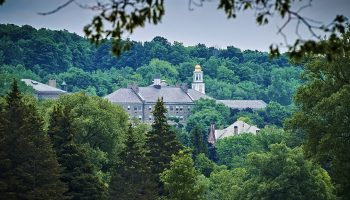The Colgate University campus, as seen amidst lush foliage from the Seven Oaks Golf Course.