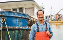 Chris Wang '94 in front of his fishing boat