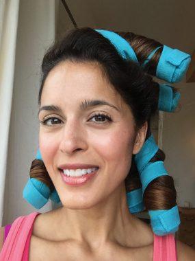 Tara Brown '98 using her Sleep Styler hair curlers