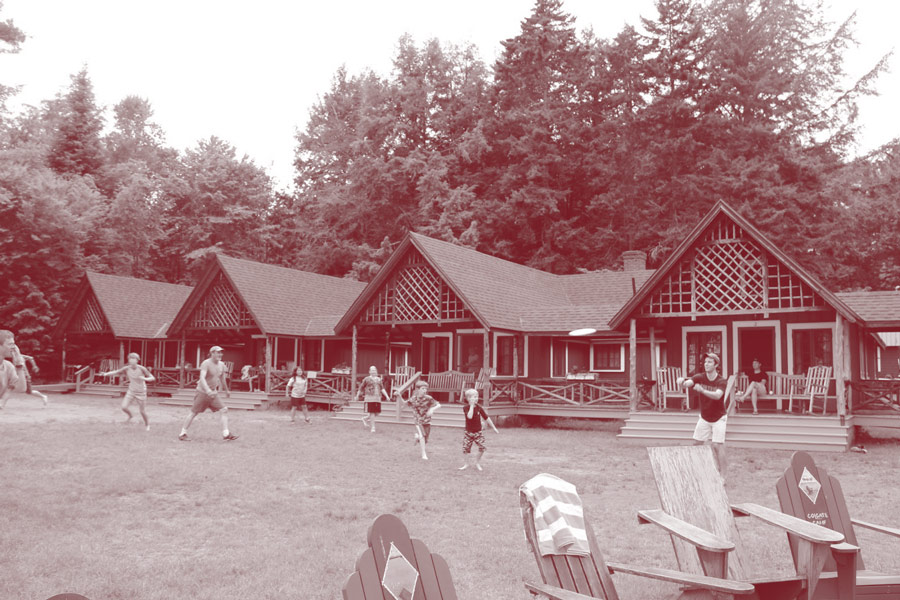Children and adults playing on the lawn of Colgate Camp