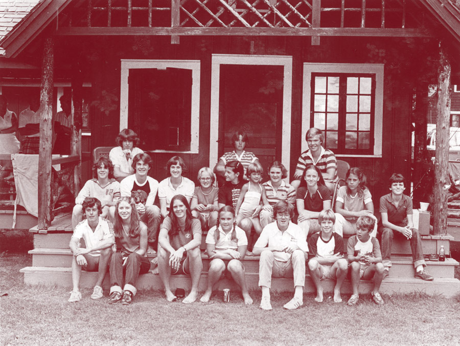 Archival photo of a group on the steps at Colgate Camp.