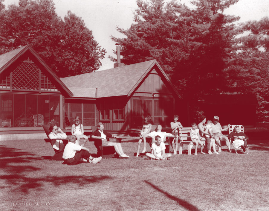 Archival photo of people relaxing on the lawn of Colgate Camp