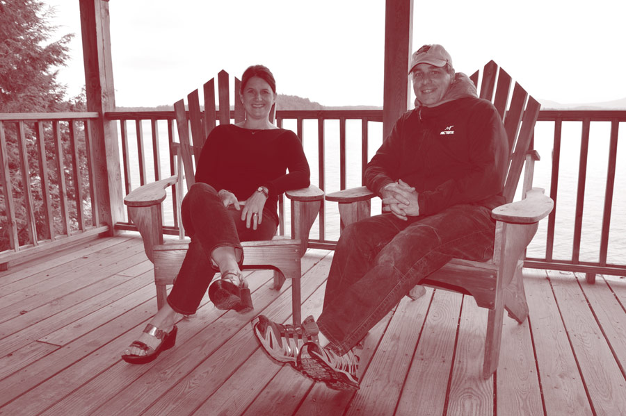 Sandy '88 and Greg Drechsel '88 in Adirondack chairs at Colgate Camp.
